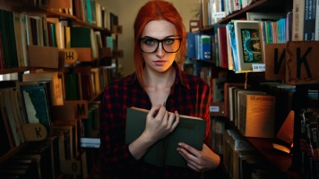 red-hair-girl-freckles-glasses-library-reading-book_1920x1080