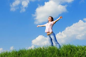 happy young woman dreams to fly on winds