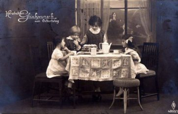 girls_with_birthday_cake-_postcard_from_1920-640x411