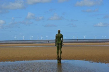 iron-man-crosby-beach-antony-gormley-rear-wind-turbines