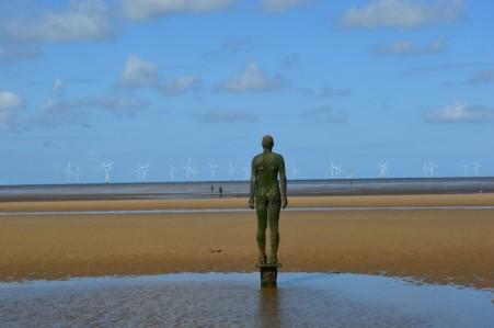 iron-man-crosby-beach-antony-gormley-rear-wind-turbines