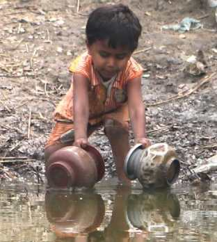water-child-filling-containers-from-dirty-pond-third-world-poverty